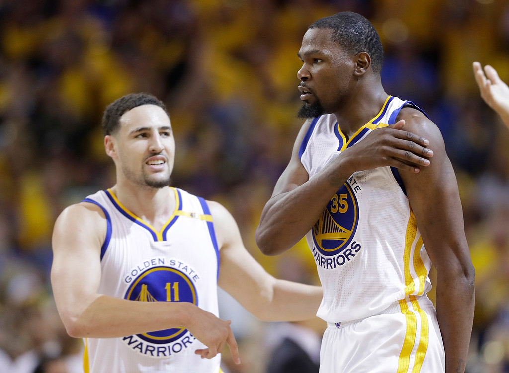 . Golden State Warriors forward Kevin Durant, (35) celebrates with Klay Thompson during the second half of Game 2 of basketball\'s NBA Finals against the Cleveland Cavaliers in Oakland, Calif., Sunday, June 4, 2017. (AP Photo/Marcio Jose Sanchez)