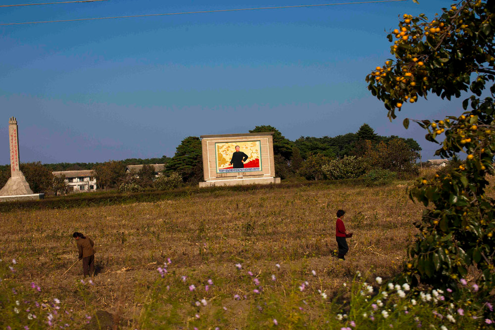 ". A portrait of North Korea\'s late leader Kim Il Sung stands in a farm field near Wason, North Korea on Oct. 6, 2011. A quasi-religious mystique surrounding the Kim family has  developed over two generations, dating back to ""eternal president\"" Kim Il Sung.  (AP Photo/David Guttenfelder)"