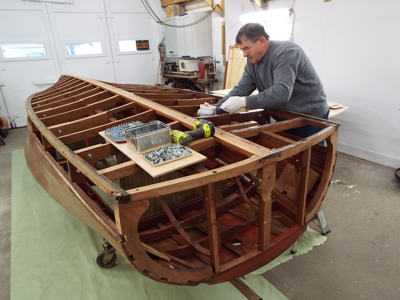 Applying epoxy to the new frames so we can installed the new bottom skin.