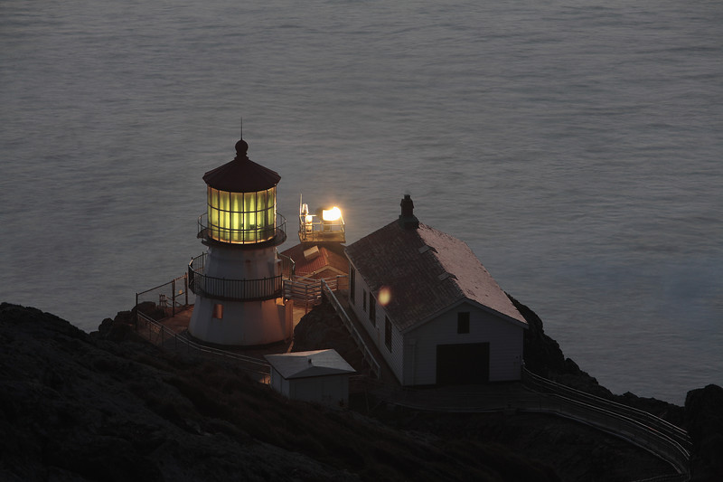 The Point Reyes Peninsula, which juts into the Pacific Ocean just north of the Golden Gate, has long been treacherous for ships traveling to and from San Francisco. In hopes of reducing the number of shipwrecks, Congress in 1852 appropriated $25,000 to build the Point Reyes Lighthouse.  Coping with the precipitous location and buying the necessary property, however, delayed construction of the forged-iron-plate building, so that the beacon did not go into operation until December 1, 1870. During the delay, at least seven more ships ran aground. It is impossible to say how many of them would have been saved by the beacon, however, for shipwrecks continued - although less often - after the lighthouse was in service. Some unfortunate skippers blamed the light itself, saying it was hard to see from the south. Others blamed the lighthouse's fog siren, saying it was hard to hear from the north.