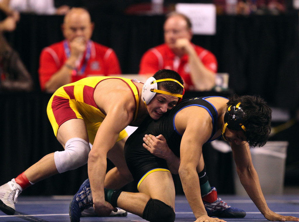 . Liberty\'s Austin Solari, left, wrestles Calvary Chapel\'s Adam Alvarado in a 132-pound consolation round match during the California Interscholastic Federation wrestling championships in Bakersfield, Calif., on Saturday, March 2, 2013. Solari would go onto win the match. (Anda Chu/Staff)