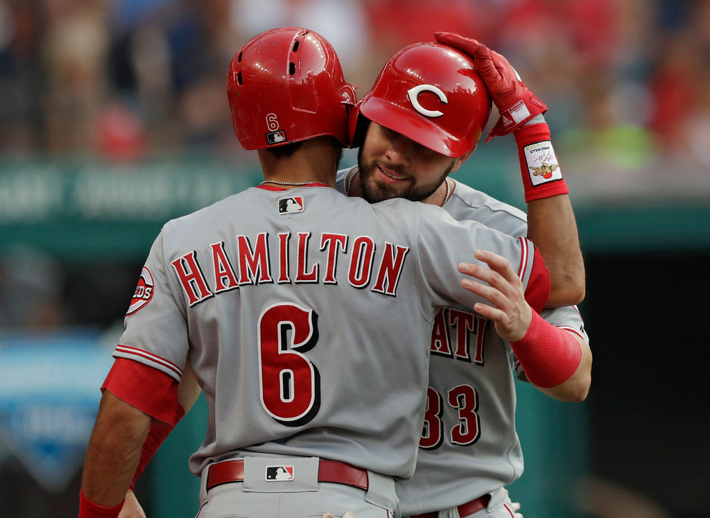. Cincinnati Reds\' Jesse Winker, right, is congratulated by Billy Hamilton after Winker scored in the fourth inning of a baseball game against the Cleveland Indians, Monday, July 9, 2018, in Cleveland. (AP Photo/Tony Dejak)