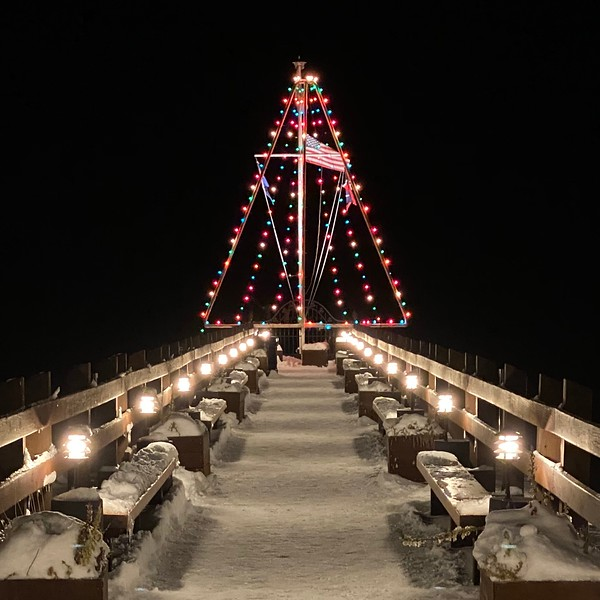 Christmas Lights Shaped like a Tree on Snow covered pier at night Lake Tahoe, California