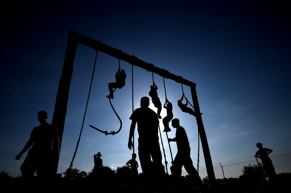 . Members of the United States Naval Academy freshman class climb ropes on a obstacle course during the annual Sea Trials training exercise at the U.S. Naval Academy on May 13, 2014 in Annapolis, Maryland. (Photo by Patrick Smith/Getty Images)