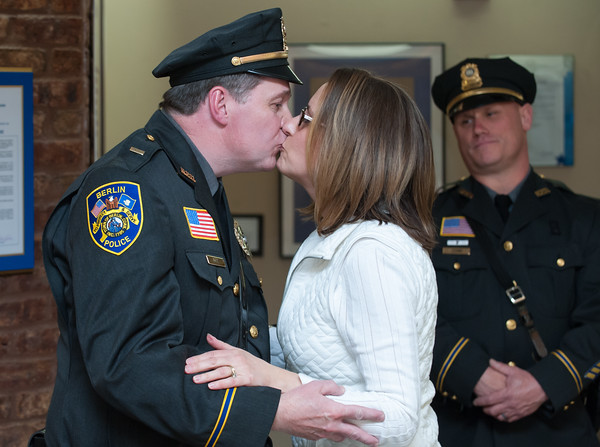 04/02/18 Wesley Bunnell | Staff The Berlin Police held a promotion ceremony on April 2nd at town hall for the newly appointed Lt. Michel Jobes and Sgt. John Flynn. Lt. Jobes kisses his wife Diane after she pins his new badge to his uniform.
