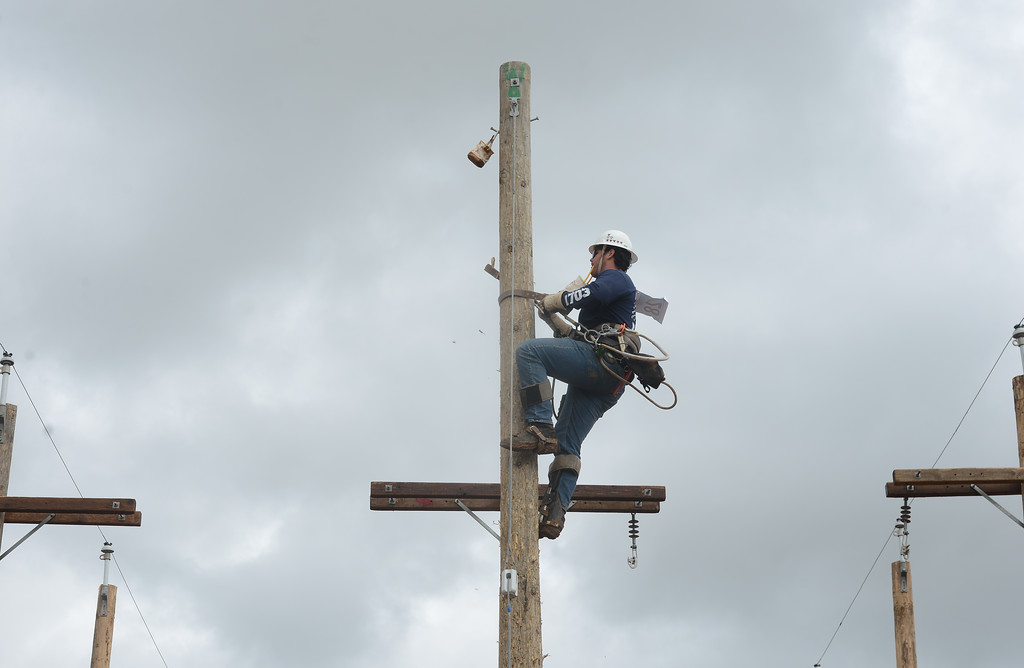 . Brady Zuniga races up a pole during the Northwest Lineman College\'s graduation rodeo, March 15, 2018, in Chico, California. (Carin Dorghalli -- Enterprise-Record)
