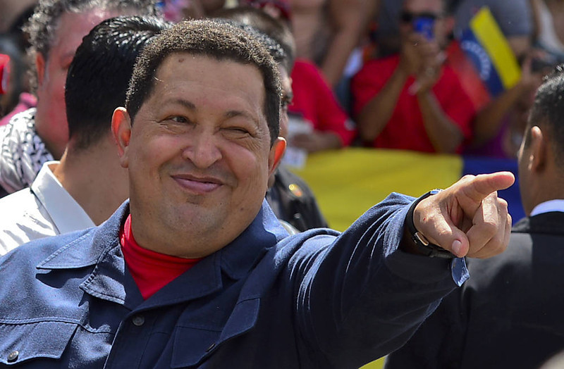 . Venezuelan President Hugo Chavez gestures before voting in Caracas on October 07, 2012.  Venezuelans voted Sunday with President Hugo Chavez\'s 14-year socialist revolution on the line as the leftist leader faced youthful rival Henrique Capriles in his toughest electoral challenge yet. AFP PHOTO/Luis  ACOSTA/AFP/Getty Images