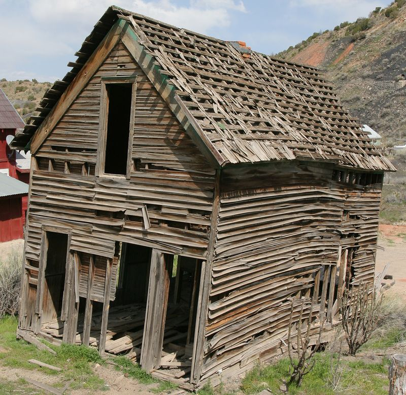 Abandoned house in Madrid, NM, now leaning significantly to the south.