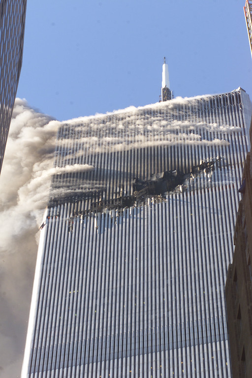 . Debris fall from one of the burning twin towers of the World Trade Center after a hijacked plane crashed into the tower on September 11, 2001 in New York City.(AP Photo/Richard Drew)