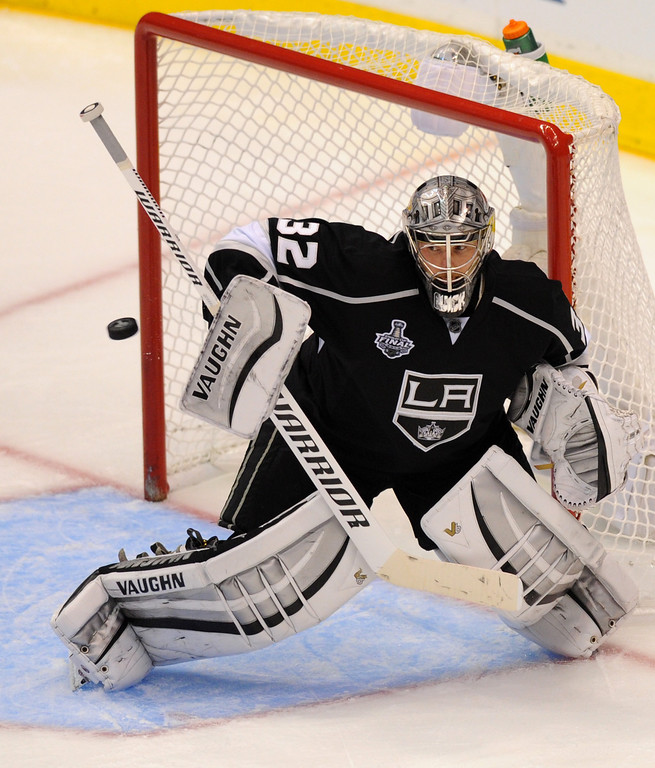 . Kings\' goalie Jonathan Quick deflects a shot against the Rangers in the third period of game two of the Stanley Cup Final, Saturday, June 7, 2014, at Staples Center. (Photo by Michael Owen Baker/Los Angeles Daily News)