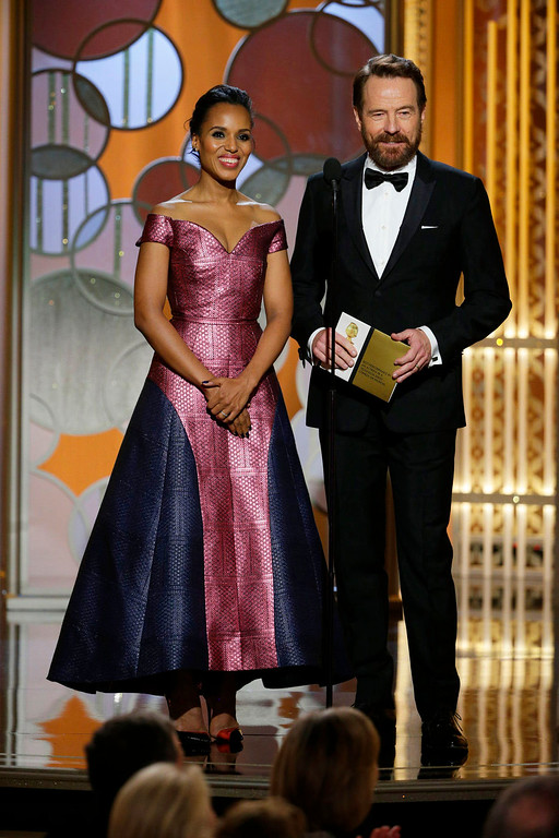 . In this image released by NBC, Kerry Washington, left, and Bryan Cranston present an award at the 72nd Annual Golden Globe Awards on Sunday, Jan. 11, 2015 at the Beverly Hilton Hotel in Beverly Hills, Calif. (AP Photo/NBC, Paul Drinkwater)