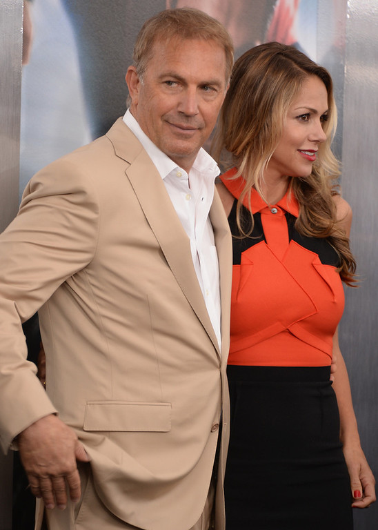 ". Actor Kevin Costner and Christine Baumgartner attend attends the ""Man Of Steel\"" world premiere at Alice Tully Hall at Lincoln Center on June 10, 2013 in New York City.  (Photo by Andrew H. Walker/Getty Images)"