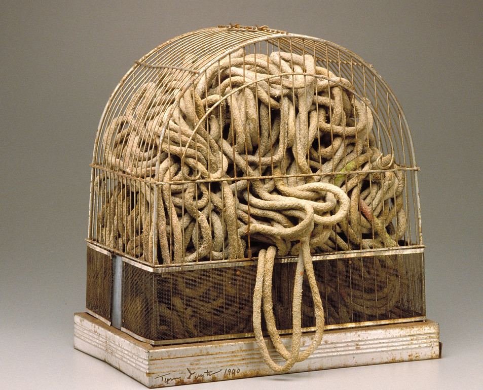 . This undated image provided by the Detroit Institute of Arts museum in Detroit shows �Caged Brain,� a mixed media work by Tyree Guyton that is part of the museum�s African-American collection. Guyton is also the artist behind Detroit�s Heidelberg Project, an ongoing open-air installation on Detroit�s East Side in which abandoned buildings are turned into works of art. The museum�s holdings were at one point threatened with a sale to help fund Detroit�s pension obligations, but finalization of the city�s bankruptcy last week included a deal that protects the art. (AP Photo/Detroit Institute of Arts)
