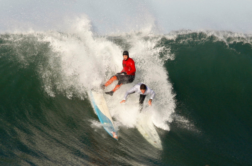 . Peter Mel, left, and Dave Wassel wipe out at the Mavericks Invitational on Sunday, January 20, 2013 at Princeton by the Sea, Calif. (Karl Mondon/Staff)