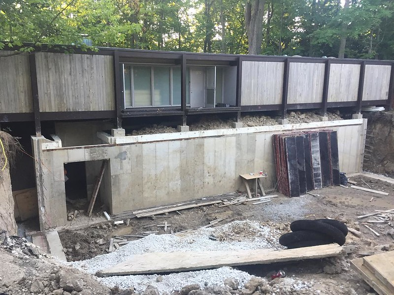 "Looks like they're adding a basement to ""Cameron's"" house from Ferris Bueker's Day Off."