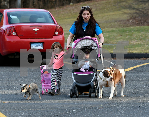 2/28/2018 Mike Orazzi | Staff Mary Ann Justice while walking with her daughters Kylie,4; Layla, 7 months and dogs Shadow, 17 years and Shiba, 6 in Bristol Page Park Wednesday afternoon.