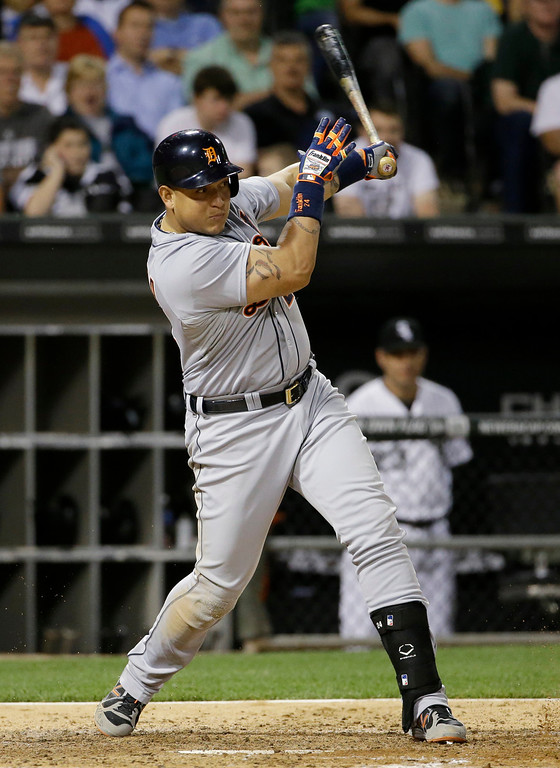 . Detroit Tigers\' Miguel Cabrera hits a two-run single against the Chicago White Sox during the eighth inning of a baseball game in Chicago on Thursday, June 12, 2014. (AP Photo/Nam Y. Huh)
