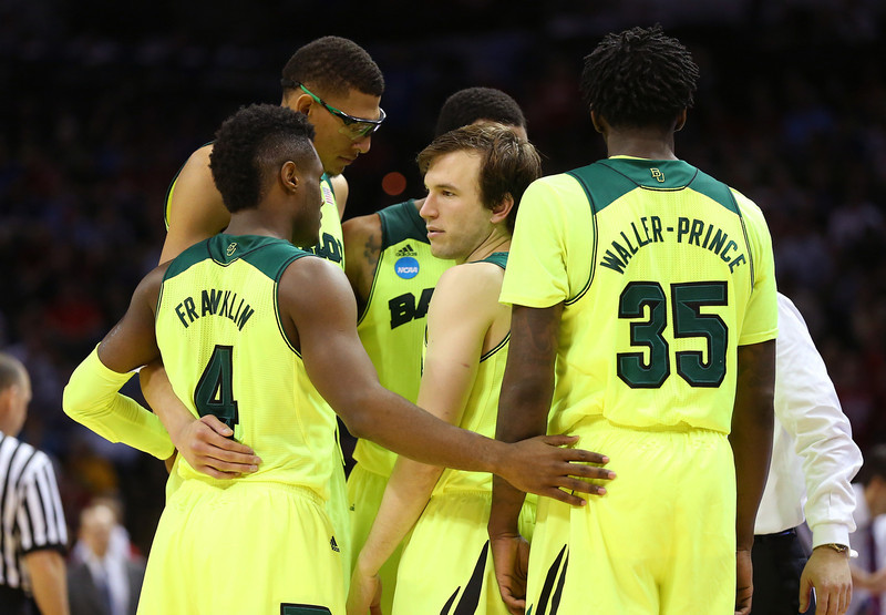 . The Baylor Bears huddle in the second half against the Nebraska Cornhuskers during the second round of the 2014 NCAA Men\'s Basketball Tournament at AT&T Center on March 21, 2014 in San Antonio, Texas.  (Photo by Ronald Martinez/Getty Images)
