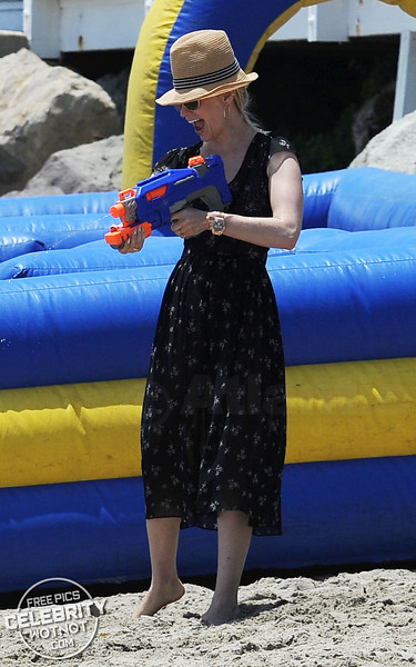 Water fight! January Jones Sprays Friends With A Water Pistol In Malibu, CA