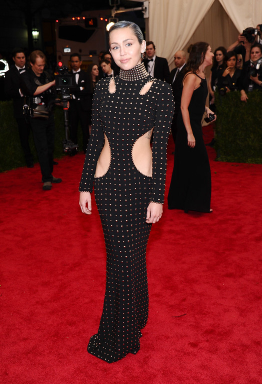 """. Miley Cyrus arrives at The Metropolitan Museum of Art\'s Costume Institute benefit gala celebrating \""""China: Through the Looking Glass\"""" on Monday, May 4, 2015, in New York. (Photo by Charles Sykes/Invision/AP)"""