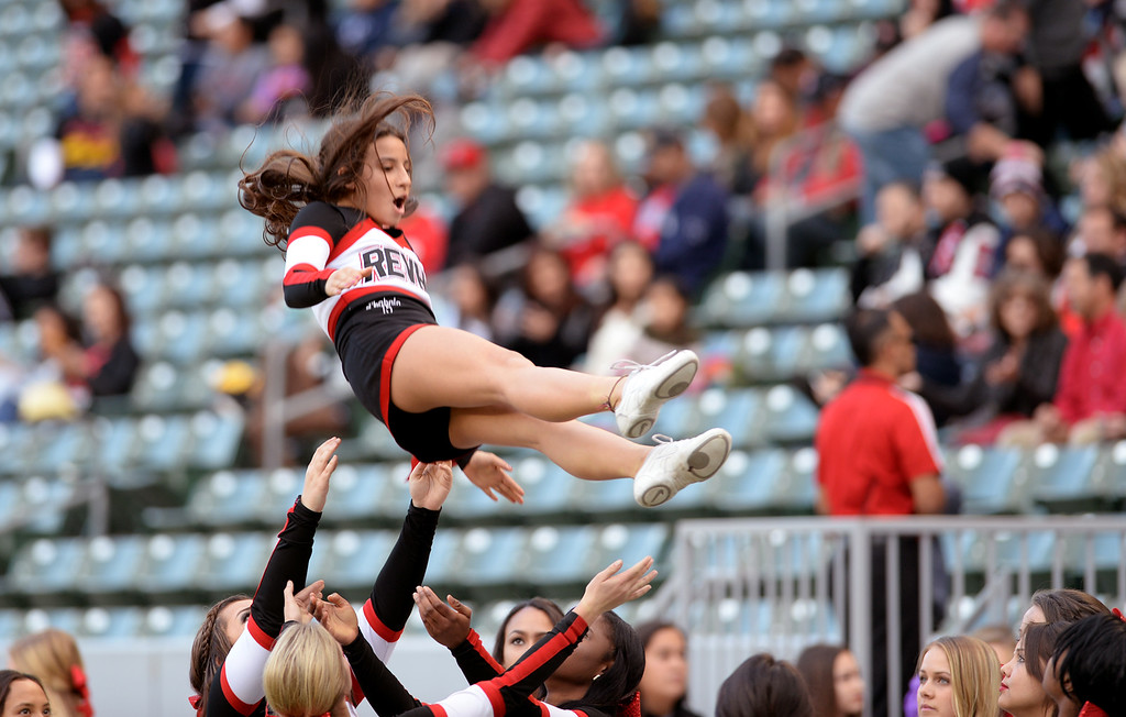 . The Redlands East Valley High School cheerleaders rehearse prior to the start of the Redlands East Valley High School vs Clayton Valley Charter CIF-State Division II championship game on Saturday, December 20, 2014 at StubHub Center in Carson, Ca. (Photo by Micah Escamilla/Redlands Daily Facts)