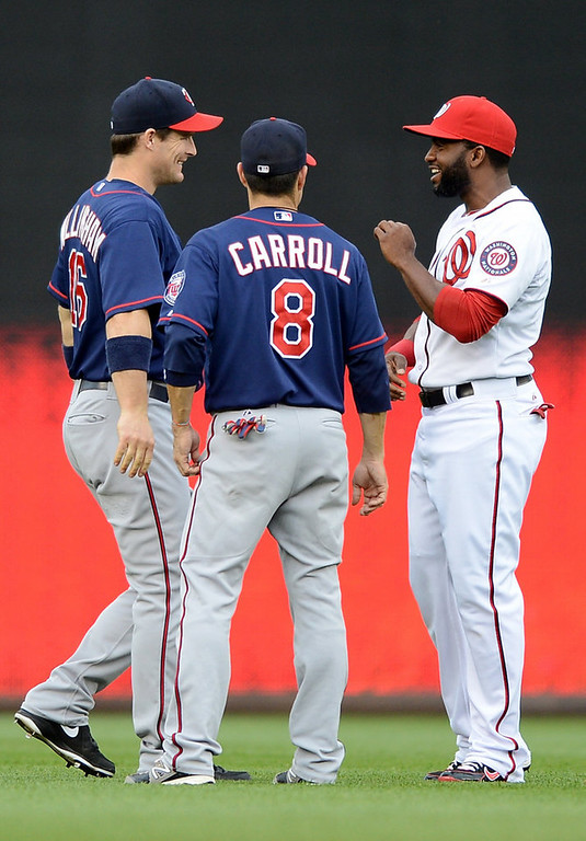 . Washington Nationals center fielder Denard Span (2), right, chats with Minnesota Twins left fielder Josh Willingham (16), left, and Minnesota Twins third baseman Jamey Carroll (8) before the start of the second game of a day-night doubleheader at Nationals Park. (Chuck Myers/MCT)