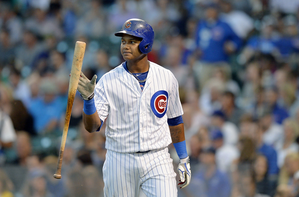 . Starlin Castro #13 of the Chicago Cubs flips his bat after popping up with runners in scoring position during the first inning against the Colorado Rockies on July 29, 2014 at Wrigley Field in Chicago, Illinois.  (Photo by Brian Kersey/Getty Images)