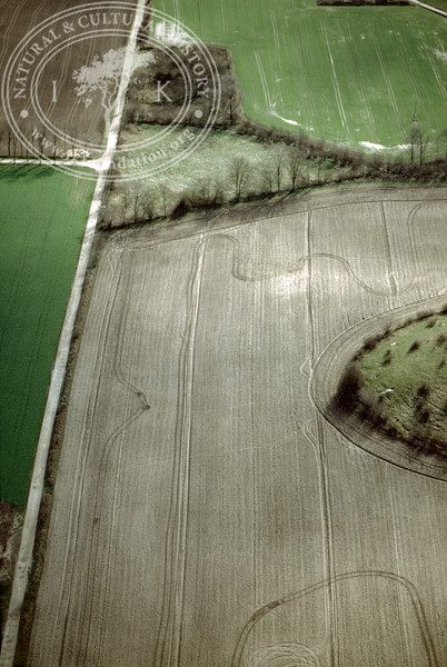 Farmland west of Ravlunda church - with plantations, buildings and prehistoric remains (2 April, 1989). | LH.0532