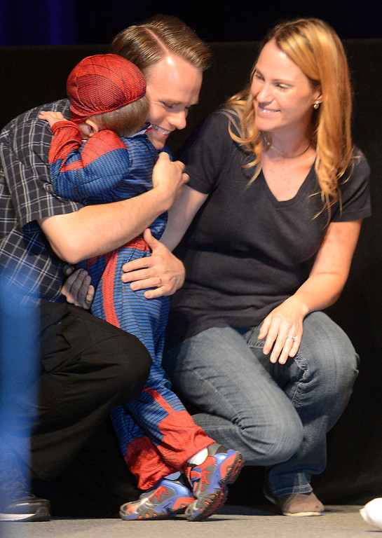 . (Will Lester/Inland Valley Daily Bulletin) Jacob Long, 5, is hugged by his father Josh, as his mother Kaylene looks on, after completing his dream wish Thursday in Ontario. Jacob Long, 5 from Mira Loma, dream of fighting along side his favorite superhero, Spiderman, came true Thursday August 22, 2013 by the Make-A-Wish Orange County/Inland Empire along with assistance from the Ontario police and fire departments. At 15 months Jacob was diagnosed with an immune deficiency disease and has had to have 2 bone marrow transplants to cure it.