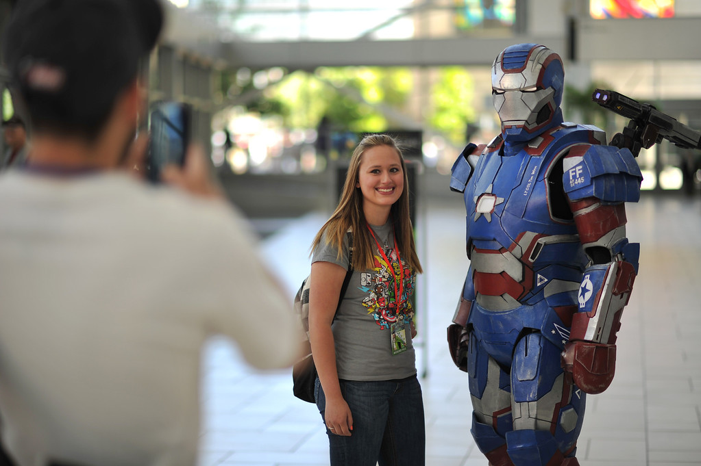 . DENVER, CO. - MAY 31: Kelsie Griego, 21, of Denver takes picture with Tim Winn, 30, with Iron Man costume during opening day of Denver Comic Con at Colorado Convention Center. Denver, Colorado. May 31, 2013. (Photo By Hyoung Chang/The Denver Post)