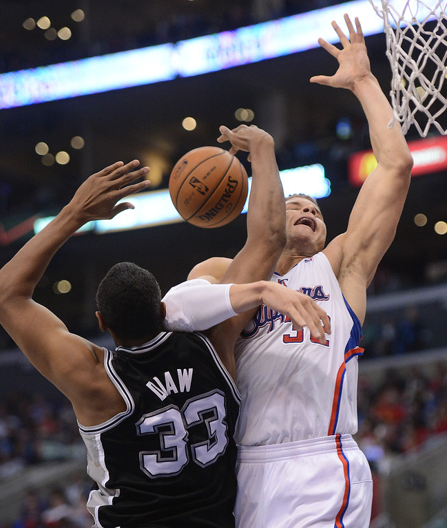 . The Clippers\' Blake Griffin #32 is fouled by the Spurs\' Boris Diaw #33 during their game at the Staples Center in Los Angeles Friday, February  21, 2013. (Hans Gutknecht/Staff Photographer)