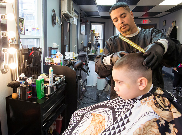 03/19/20 Wesley Bunnell | StaffrrRichard Paul who uses the name Richy Cuts in his barber shop Industry Hair Studio located at 368 Farmington Ave cuts Jonathan Rodriguez-Villas hair , age 11, on Thursday March 19, 2020.