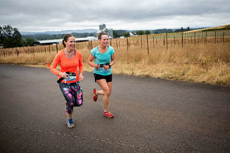 Michele Adams and Dija Fraser prepare to cross the finish line after running up, up, up the Dundee hills and down during the Fueled by Fine Wine 1/2 Marathon this past weekend.