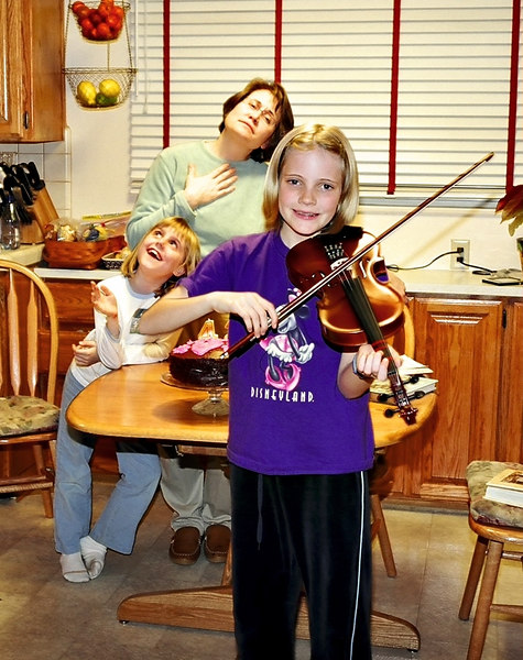 Emily plays a sad sad song on her viola; Elena and Shelly are moved by the music.