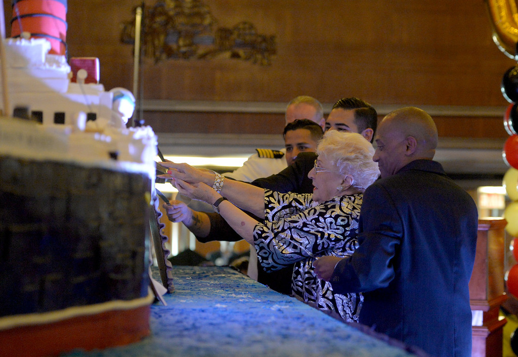 . June Allen, who sailed on the Queen Mary from England to America after World War II, joins in the cake cutting to celebrate its 80th anniversary of her launching in Long Beach, CA on Friday, September 26, 2014. After some speeches and a short film, guests were able to sample a slice of cake from a 15-foot long, 600-pound replica of the ship made by baker Jose Barajas. (Photo by Scott Varley, Daily Breeze)