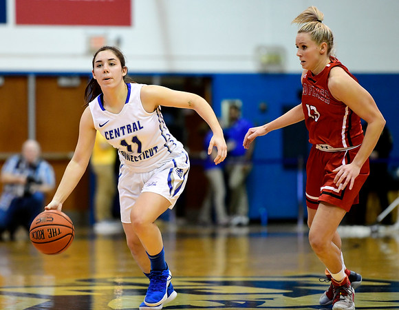 1/19/2019 Mike Orazzi | Staff CCSU's Bruna Vila Artigues (11) and Saint Francis University's Sam Sabino (13) during Saturday's women's basketball game in New Britain.