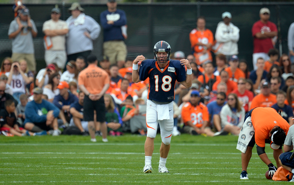 . Denver Broncos quarterback Peyton Manning (18) calls out the play during training camp July 29, 2013 at Dove Valley. (Photo By John Leyba/The Denver Post)