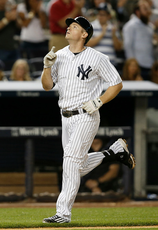 . New York Yankees Chase Headley watches his fifth-inning, solo home run off Detroit Tigers starting pitcher Justin Verlander in a baseball game at Yankee Stadium in New York, Wednesday, Aug. 6, 2014.  (AP Photo/Kathy Willens)
