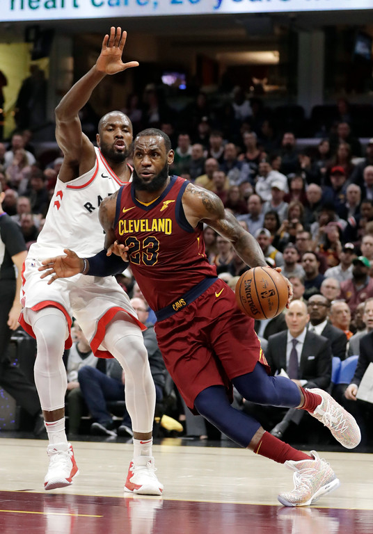 . Cleveland Cavaliers\' LeBron James (23) drives past Toronto Raptors\' Serge Ibaka (9) during the second half of an NBA basketball game Wednesday, March 21, 2018, in Cleveland. The Cavaliers won 132-129. (AP Photo/Tony Dejak)