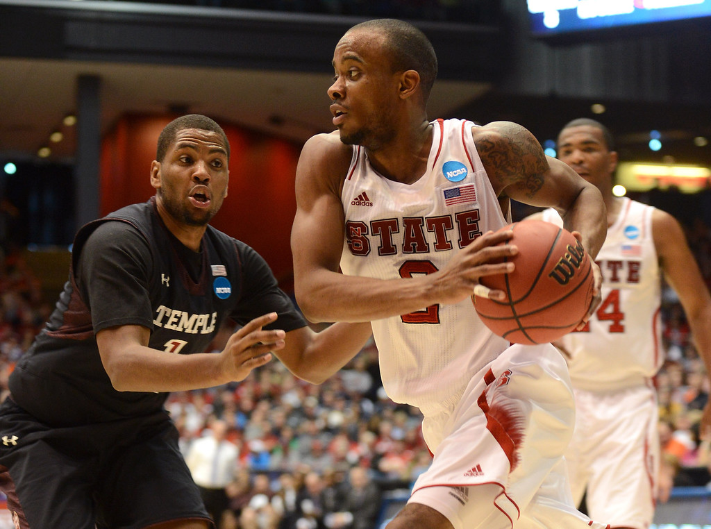 . DAYTON, OH - MARCH 22: Lorenzo Brown #2 of the North Carolina State Wolfpack drives to the basket against Khalif Wyatt #1 of the Temple Owls in the second half during the second round of the 2013 NCAA Men\'s Basketball Tournament at UD Arena on March 22, 2013 in Dayton, Ohio.  (Photo by Jason Miller/Getty Images)