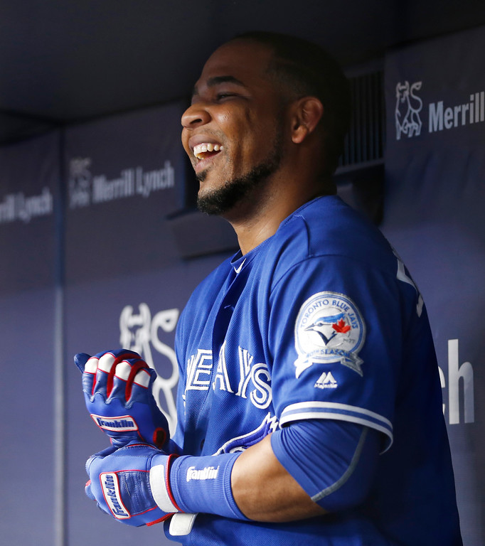 . Toronto Blue Jays Edwin Encarnacion laughs in the dugout after hitting a game-tying, two-run home run in  a baseball game against the New York Yankees in New York, Tuesday, Aug. 16, 2016. (AP Photo/Kathy Willens)