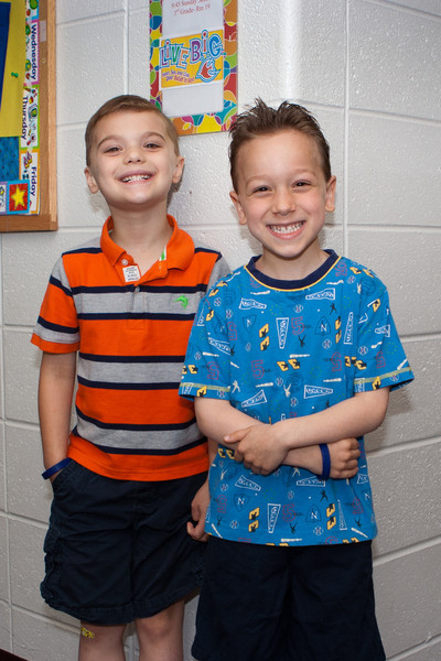 Amleto and KC posing outside their classroom.