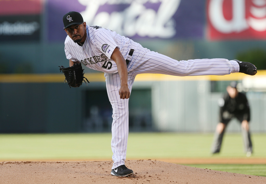 . Colorado Rockies starting pitcher Franklin Morales works against the New York Mets in the first inning of a baseball game in Denver, Saturday, May 3, 2014. (AP Photo/David Zalubowski)
