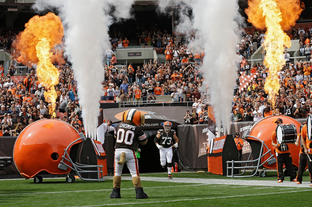 . Amid smoke and flames, Cleveland Browns tackle Joe Thomas (73) runs onto the field before an NFL football game against the Cleveland Browns Sunday, Sept. 29, 2013, in Cleveland. Thomas was playing in his 100th career NFL game. (AP Photo/Mark Duncan)