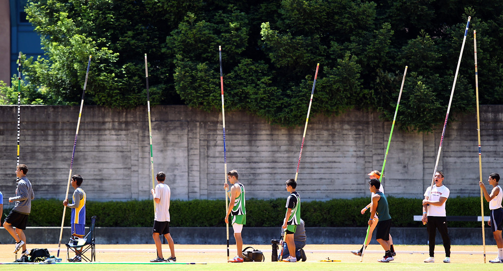 . Pole vaulters line up during warm ups at the North Coast Section Meet of Champions at Cal\'s Edwards Stadium in Berkeley, Calif., on Saturday, May 25, 2013. (Anda Chu/Bay Area News Group)