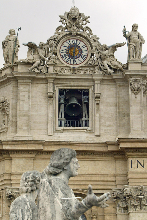 . The giant bells of St Peter\'s Basilica ring after white smoke billowed from the chimney of the Sistine Chapel meaning that Catholic Church cardinals had elected a new leader after a conclave lasting little more than 24 hours, 19 April 2005 at the Vatican City. VINCENZO PINTO/AFP/Getty Images
