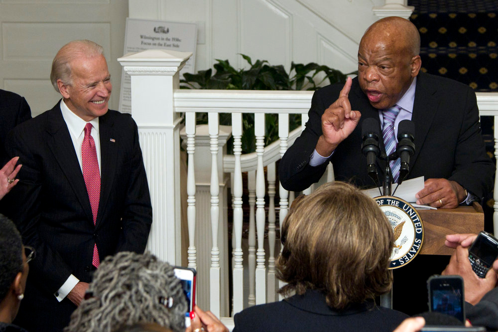 Description of . Rep. John Lewis, D-Ga., right, speaks as Vice President Joe Biden listens during the 3rd Annual Black History Month Reception at the Vice President's Residence at the Naval Observatory, Monday, Feb. 27, 2012, in Washington. (AP Photo/Carolyn Kaster)