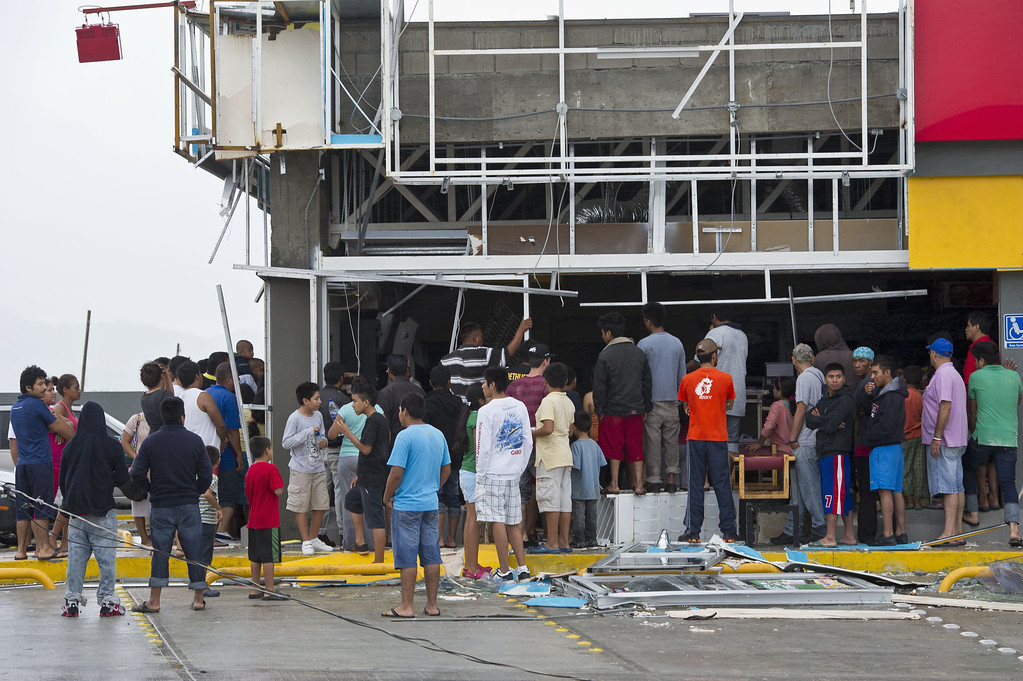 . Members of the Mexican Navy keep looters at bay at supermarket damaged by hurricane Odile in Cabo San Lucas in Mexico\'s Baja California peninsula on September 15, 2014.  AFP PHOTO/RONALDO  SCHEMIDT/AFP/Getty Images