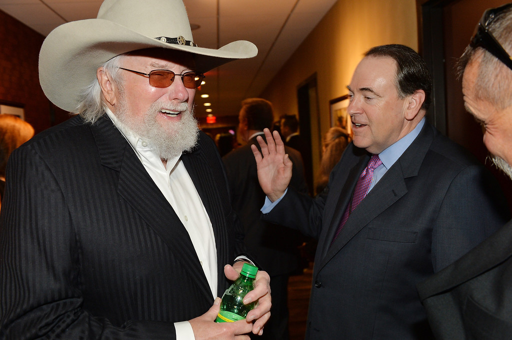 . Country musician Charlie Daniels (L) and former Arkansas governor Mike Huckabee attend the funeral service for George Jones at The Grand Ole Opry on May 2, 2013 in Nashville, Tennessee.  (Photo by Rick Diamond/Getty Images for GJ Memorial)