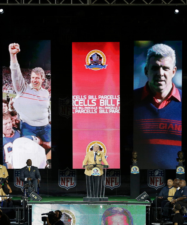 . Former NFL football head coach Bill Parcells speaks during the induction ceremony at the Pro Football Hall of Fame Saturday, Aug. 3, 2013, in Canton, Ohio. (AP Photo/Tony Dejak)